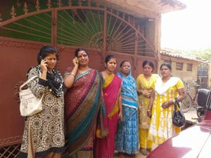 The complainant Sandhyarani Tripathy (Second from right, with hands clasped), along with women's activists at the DCP office in  Bhubaneswar on Wednesday