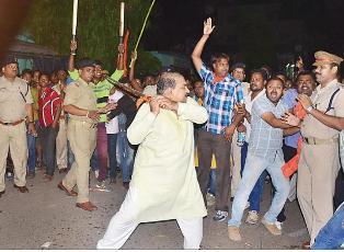 BJP leader Jayanarayan Mishra wielding a sword during Hanuman Jayanti in Sambalpur.