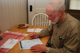 old man filling up a form