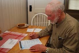 old man filling up a form