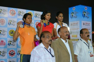 Srabani and Dutee on the winners' podium with their medals