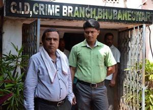 Manoj Patnaik (with towel around the neck) at the Crime Branch office after his arrest by the EOW