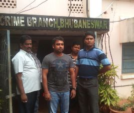 Deb Kumar Panda (middle) in EOW custody on Sunday (Pic: Biswaranjan Mishra)