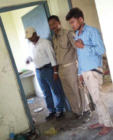 Police with the accused Surendra at the house where the minor girl was confined before her death. (Pic: Biswaranjan Mishra)