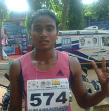 Purnima Hembram falshing the victory sign after winning the gold in the women's heptathlon event