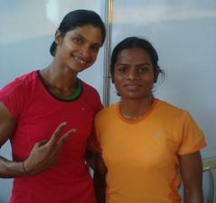 Srabani Nanda (left) and Dutee Chand (right) exult after winning the gold and silver medal respectively at the Federation Cup senior athletics meet at Managalore today