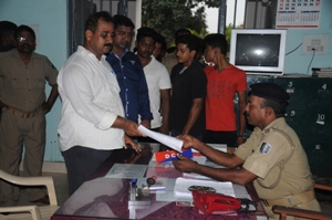 An office bearer of the Odisha Bikash Parishad handing over an FIR agianst PCC President Prasad Harichandan at the Capital police station in Bhubaneswar on Saturday (OST Photo)
