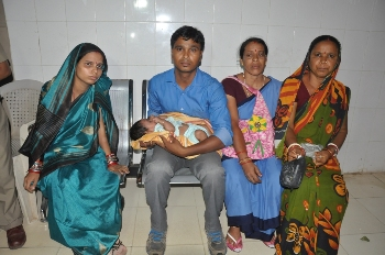 Madhusmita Maharana (left) with her husband (with the baby on his lap) and two other relatives at the Capital Hospital on Tuesday (OST Photo)