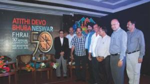 Tourism minister Ashok Panda with office bearers of the hotels and restaurant association at the inauguration of the logo for the FHRAI convetntion in Bhubaneswar on Sunday