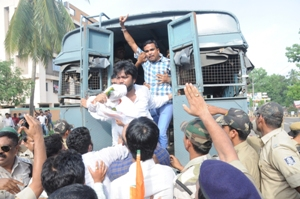 Youth Congress activists being taken away in a police van from the Airport Square while marching to Naveen Nivas on Thursday (OST Photo)