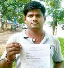 Good samaritan Sibasankar displaying the letter from the Chief Minister's office declining his contribution