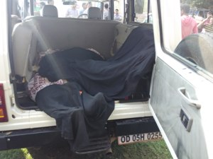 The bodies of the two alleged Maoists being carried away in a police vehicle