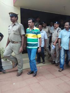 Ranjan Das being led away by police after his arrest