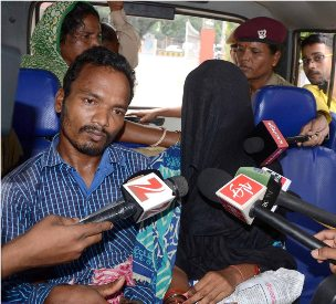 Sujata Pradhan (in veil) and Prabhat Pradhan (in blue striped shirt) accosted by TV crews in Bhubaneswar on  Sunday (OST Photo)