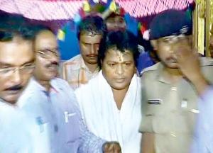 Sarathi Baba being taken away by Crime Branch sleuths from his ashram