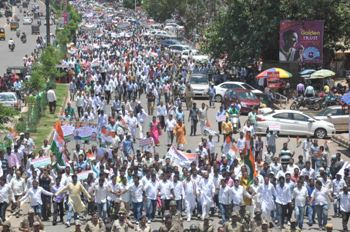 Congress workers marching to the Raj Bhavan on Monday (OST Photo)