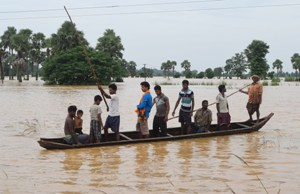With roads submerged, boats are the only mode of transport for the people in many of the flood affected areas