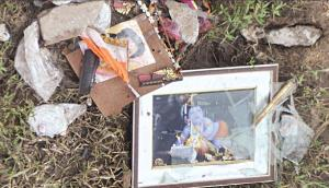 Pictures and other articles used to worship Sarathi Baba thrown on the banks of Kuakhai river by disillusioned devotees