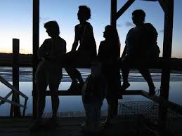 four girls in silhouette