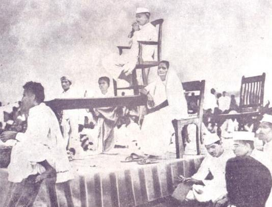 Gandhi's first tour to Odisha in 1921. Kasturba is seated on Chair and Gopabandhu on the edge of the dias.
