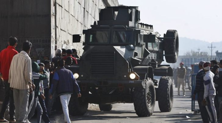 An Indian armored vehicle moves near an Indian air force base in Pathankot, 430 kilometers (267 miles) north of New Delhi, India, Saturday, Jan. 2, 2016. Gunmen attacked the air force base near the border with Pakistan on Saturday morning and exchanged fire with security forces, officials said. (AP Photo/Channi Anand)