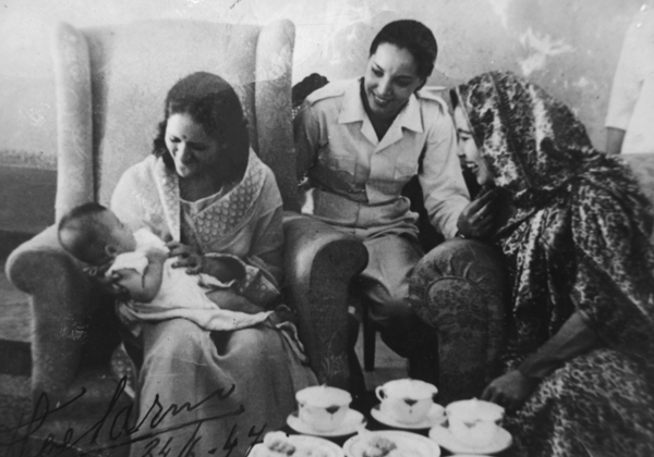 Gyan Patnaik with baby Meghabati (President Sukarno's daughter) during ill Indonesia