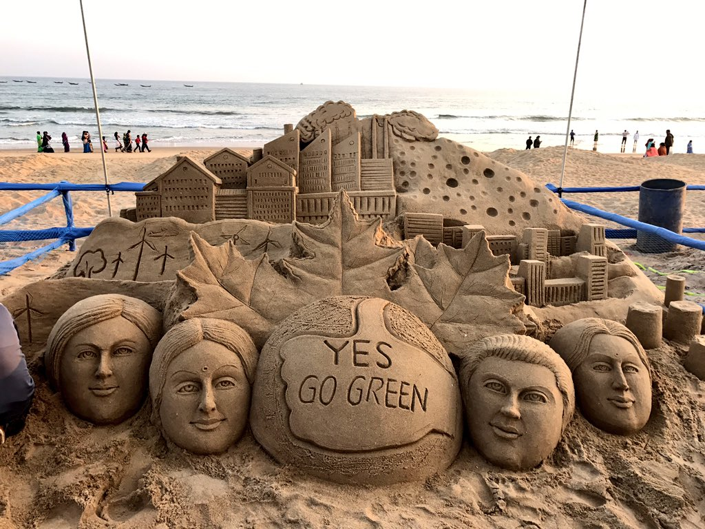 sand-art-climate-change1