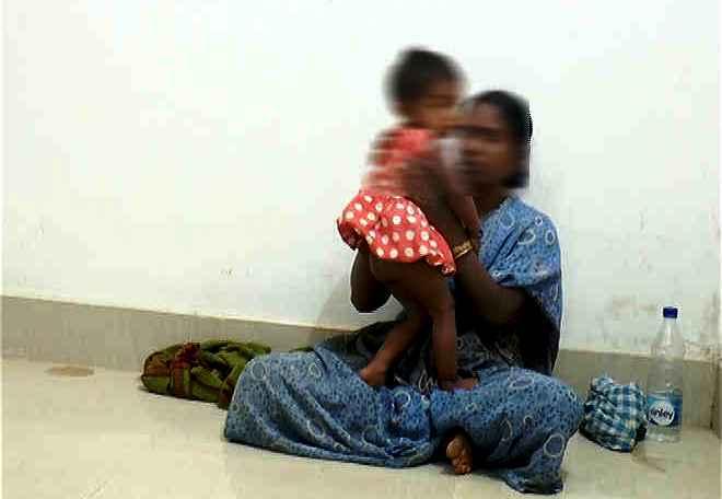 woman child in police custody