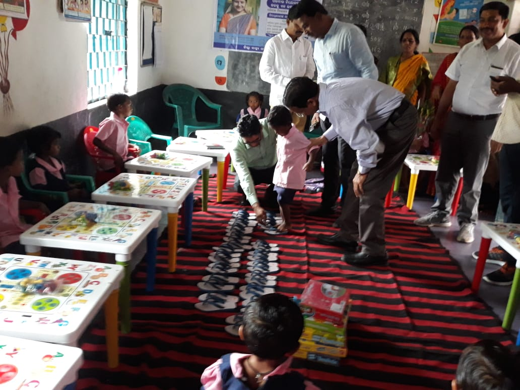 collector helps students wear slippers