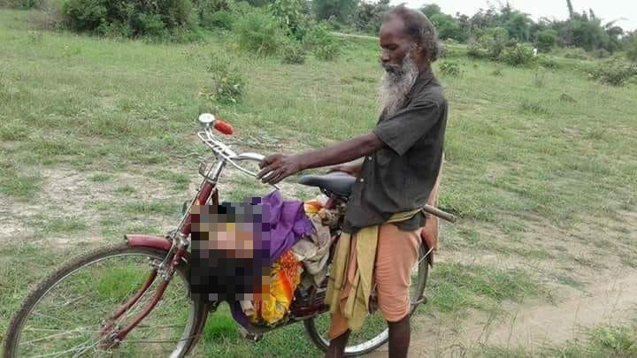 man carried body on cycle_censored (2)