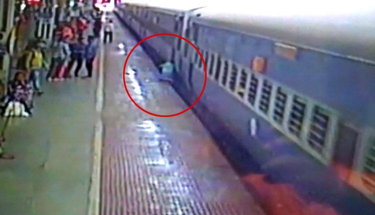 Man slips down platform
