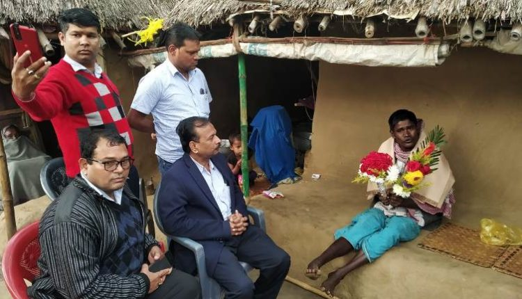 nesco officials at poor man's house