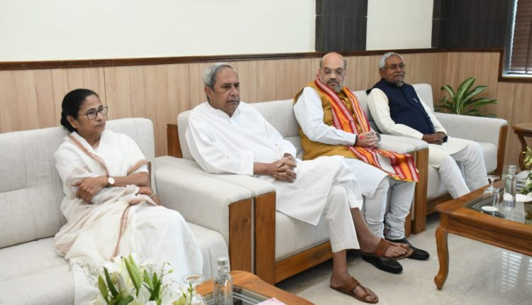 naveen with amit shah