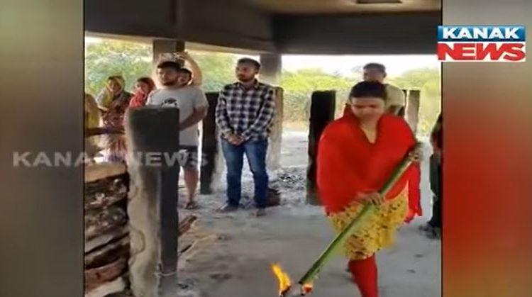 woman lit funeral pyre