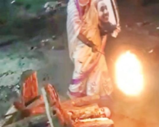 woman lights funeral pyre