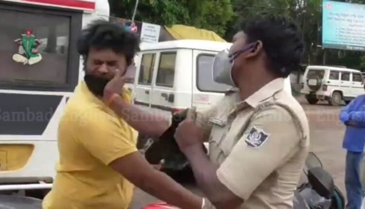 police slapping motorcyclist