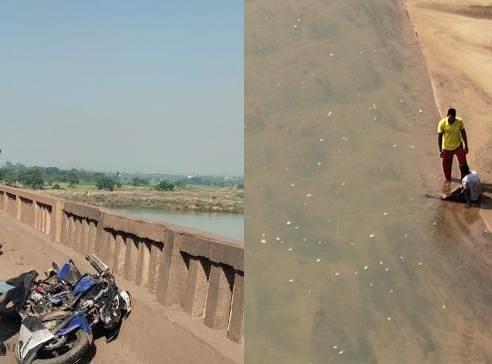 man falls into river