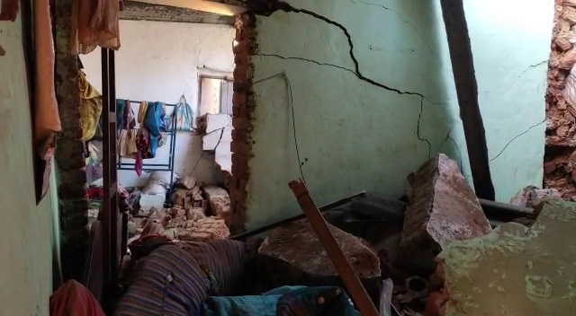 truck rams into house