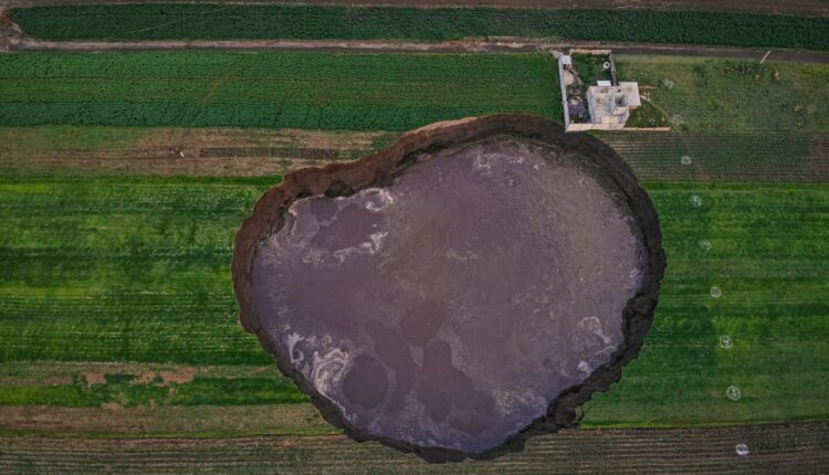 """From a bird's eye view, a large crater filled with water can be seen. (to dpa """"Huge crater in Mexico puzzles"""") (Photo:Karlos Pinpunk/dpa/IANS)"""